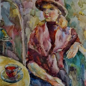 woman sitting at the table in the cafe