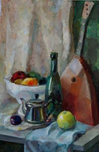 balalaika with a bowl of fruits , bottle , tea pot and an apple
