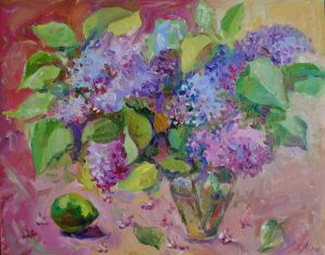 bunch of lilac in a vase on a table